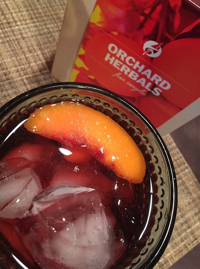 Raspberry Tea with a Frozen Peach Slice